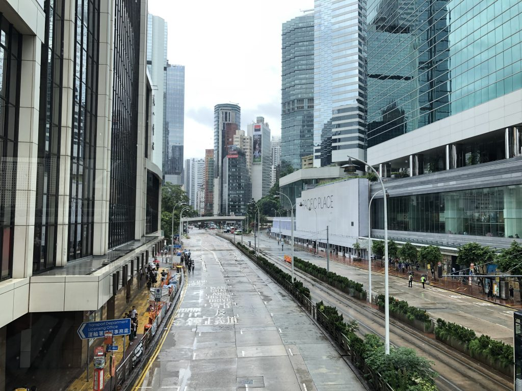 Main thoroughfare on Hong Kong Island is cleared of traffic after barricades have been mounted by protestors.
