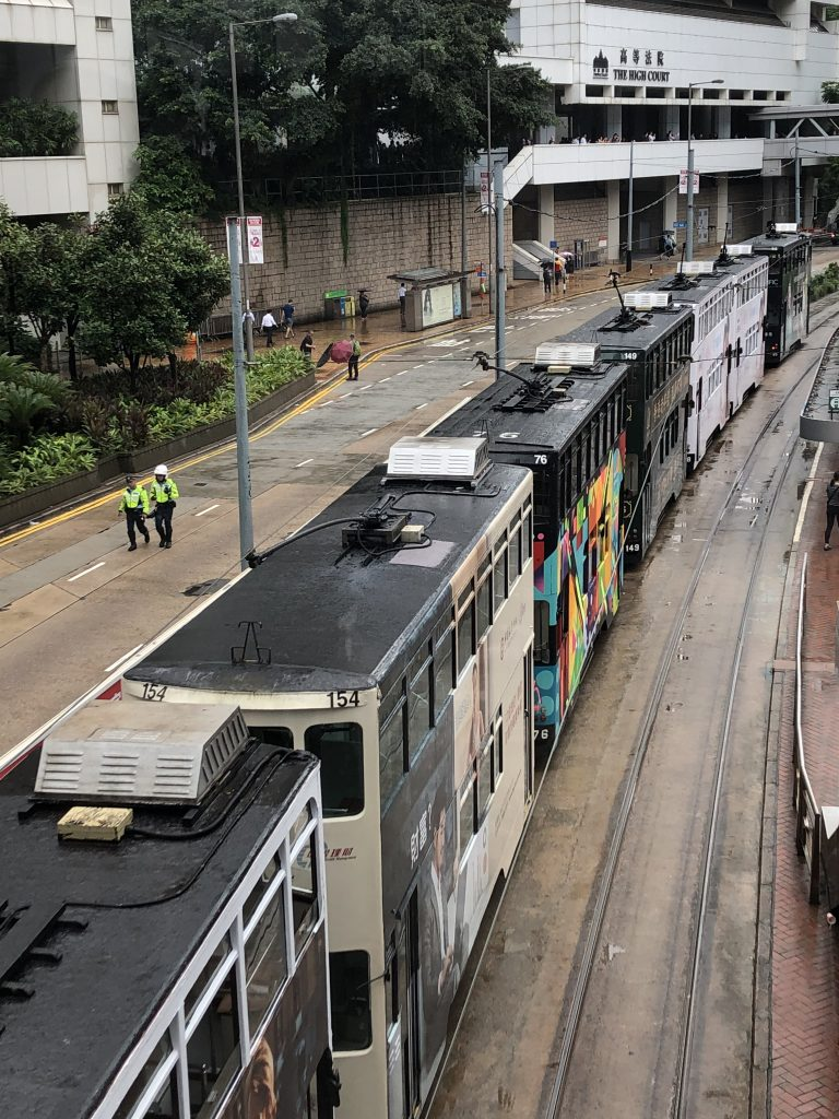 Empty trams parked on occupied streets as traffic came to a halt.